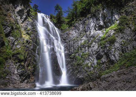 Long Daytime Exposure Of The Huge Waterfall Of Saut Deth Pish In The Aran Valley, Catalan Pyrenees,