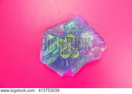 Purple Neon Slime And Glass Flower Decorative Elements.  Liquid Art Gel Background. Pink Neon Backgr