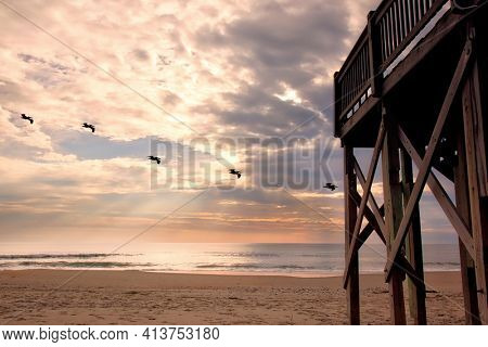 Sunrises on the Outer Banks of North Carolina are spectacular.  This beach is a popular vacation travel destination and the ocean is the main attraction.