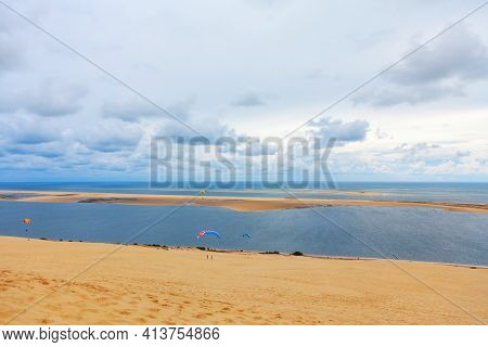 Paragliding At Atlantic Ocean Coast . Scenery Of Banc D'arguin Island Of Atlantic Littoral . Beautif