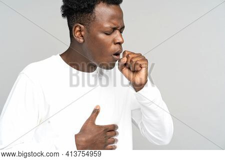 Sick African American Man Strongly Coughing. Black Man Feeling Unwell, Suffered From Asthma, Flu, Al