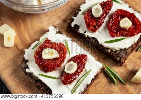 Homemade Multigrain Bread Sandwiches With Cream Cheese And Sun-dried Tomatoes On A Wooden Platter, C