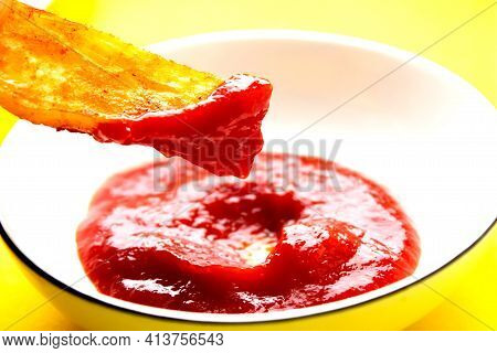 Fried Fries And Tomato Sauce On A Yellow Background. Fast Food. Rustic Potatoes Baked In The Oven. S