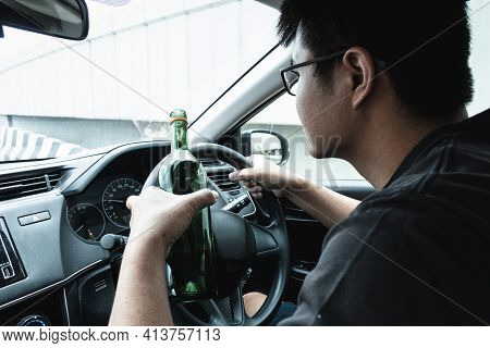 Man Driver Drinking Alcohol And Drunk While Driving A Car, Drunken Man Lose Control And Visual Visib