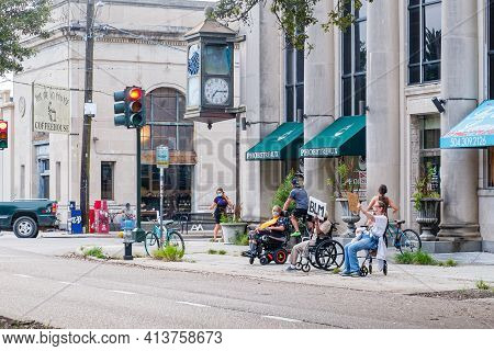 New Orleans, La - September 24: Wheelchair Bound Black Lives Matter Supporters Demonstrate On Street