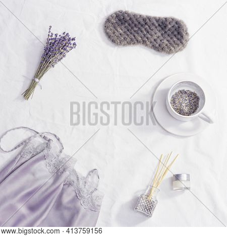 Healthy Night Sleep Concept, Silk Pajamas, Sleep Mask, Cup Of Lavender Tea, Aromas For Better Fallin
