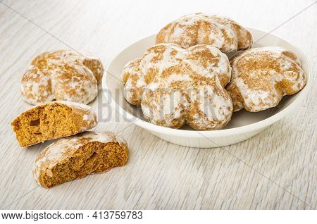 Whole Gingerbread, Broken Gingerbread, White Plate With Glazed Cookies On Light Wooden Table