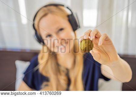 Young Woman, A Digital Artist, Dj Creates Digital Art On A Tablet At Home And Shows A Coin With The
