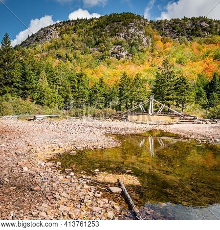 Hiking trail with a foot bridge in Acadia National Park in Maine