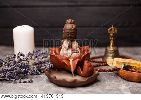 Buddha Statue In The Smoke Of Incense On Black. Candle Incense. Calming Zen Interiors With Buddha St