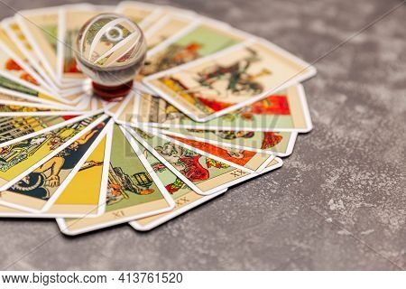 Tarot Cards And Magic Crystal Ball. Set Of Tarot Cards On The Table. Crystal Ball To Predict The Fat