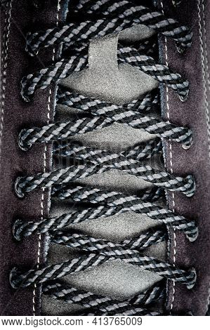 Men's Gray-brown Sports Shoes Laced With Laces. Close-up Shot.