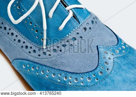 Blue Imitation Leather Shoes Laced With White Laces. Close-up Shot.