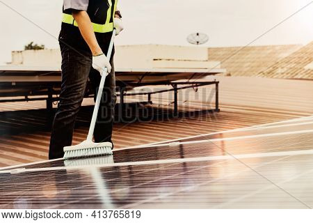 Cleaning And Inspection Of Solar Panels On The Roof Of Industrial Plants : Asian Technician Is Clean
