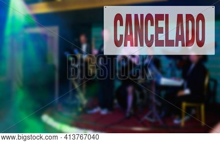 Spanish Inscription Canceled. Warning Sign Saying That Music Concert Is Cancelled Due To Coronavirus