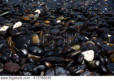 Close-up View Of Smooth Black Stones At Koh Hin Ngam, Satun Province, Thailand.