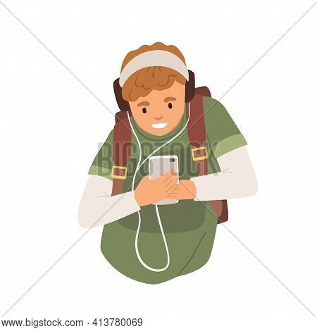 Young Student In Headphones Listening To Music Using Mobile Phone. Happy Teenager Holding Smartphone