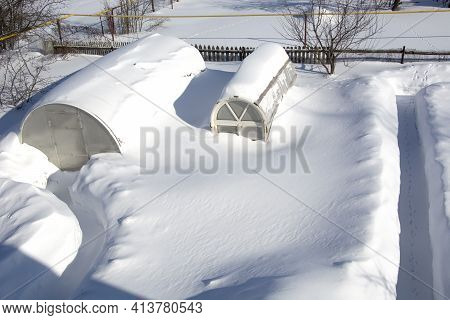 Summer Cottages In The Snow. The Greenhouses Are Completely Covered In Snow. View From Above. Snow C