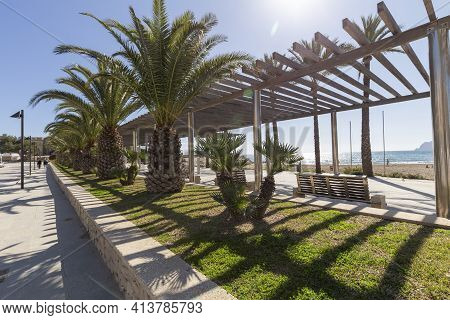 Coast Of The Mediterranean Sea In The Resort Town Of Moraira, Overlooking The Promenade With A Pergo