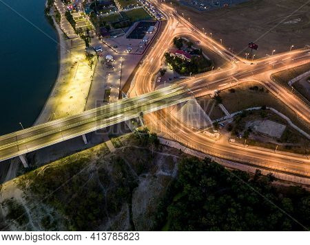 Aerial Top View Of Junction Of Road Shaped Like A Triangle. Modern Transportation, Multilevel Juncti