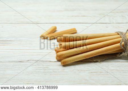 Tasty Grissini Breadsticks On White Wooden Background