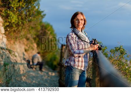 Close Up Portrait Of Lovely Middle Aged Woman With Dslr Photo Camera. Attractive Thoughtful Mature W