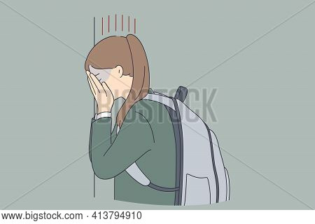 Depression, Child Bullying At School Concept. Sad Unhappy Depressed Young Schoolgirl Covering Her Fa