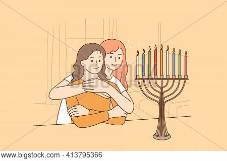 Celebrating Holy Hanukkah Holiday Concept. Two Happy Jewish Sisters Sitting Hugging Looking At Beaut