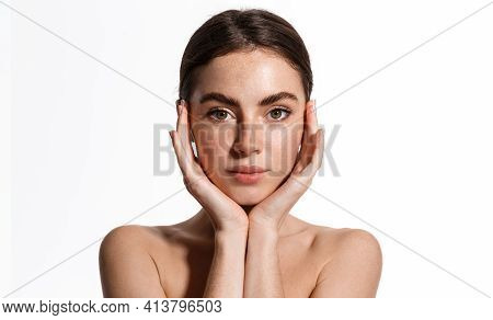 Beautiful Young Woman With Clean Perfect Skin. Portrait Of Beauty Model With Natural Nude Make Up An