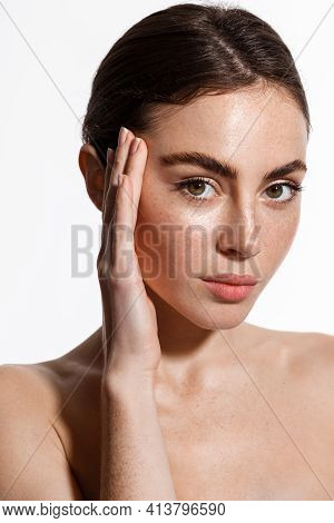 Beauty Woman With Freckles, Thick Eyebrows, Touching Face, Using Skin Care Lotion, Anti-aging Mask W