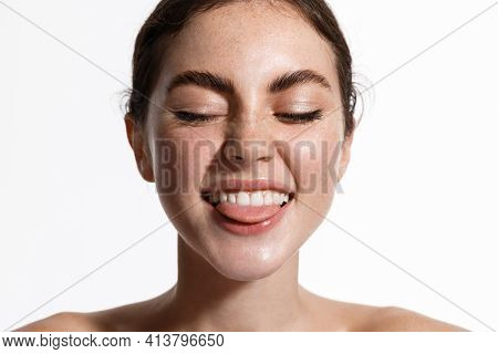 Beauty Women Portrait With Freckles, Clean And Healthy Glowing Skin, Showing Perfect White Smile And