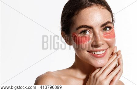 Beauty Woman With Under-eye Patches For Puffiness And Dark Circles Treatment, Smiling, Showing Glowi
