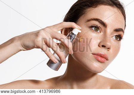 Clean Fresh Skin. Beauty Woman Face With Thick Eyebrows And Freckles, Apply Skincare Treatment, Faci