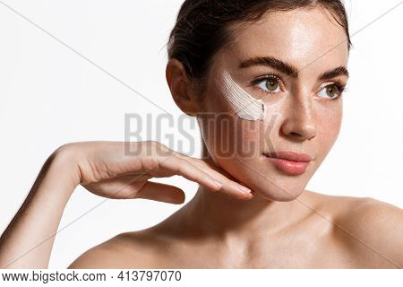 Beauty Woman Applying Face Cream On Clean Fresh Skin, Detoxifying Effect, Moisturize And Hydrate Fac