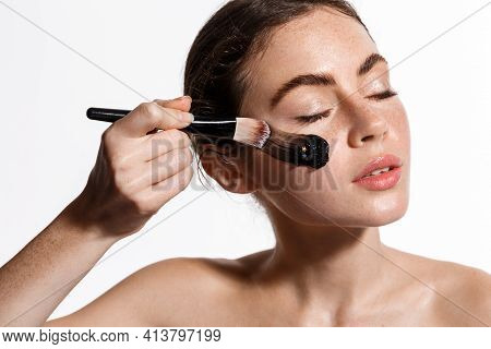 Beauty Girl Apply Face Mask From Acne On The Face With Make Up Brush To Rejuvenate Skin. Cosmetology
