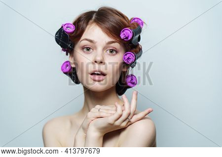 Wind Curls Of Hair Purple Curlers On The Head Of A Red-haired Woman