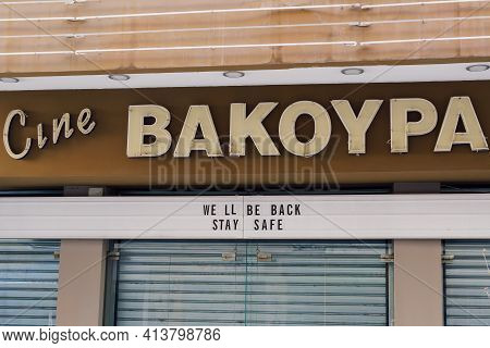 Thessaloniki, Greece March - 13 2021: We Will Be Back Stay Safe Sign On Cine Entrance. Closed Due To