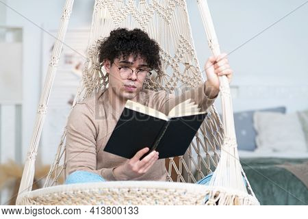 Handsome Guy Student In Glasses, Young Serious Intelligent Man Reader Is Reading Interesting Book Si