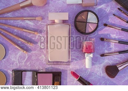 Cosmetics Makeup Product On Purple Mulberry Paper Background.