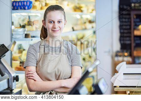 Portrait Ot Teenage Girl Working In Delicatessen Food Shop As Job Experience