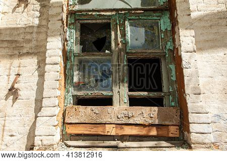Damaged Window With Broken Glass In Old Abandoned House. A Broken Glass Window Of Abandoned House.