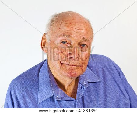 portrait of smiling happy elderly man in front of a white background poster