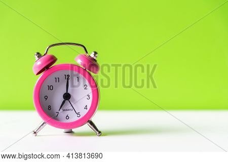 Alarm Pink Vintage Alarm Clock Falling On The Floor With Green Color Background, Copy Space For Tex.