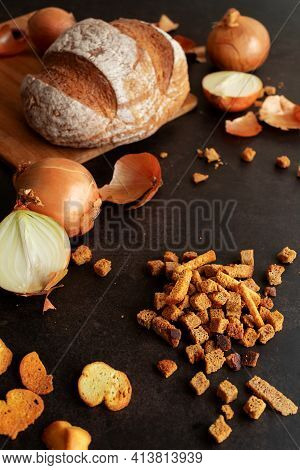 Dry Bread, Croutons With Onions On A Dark Background, Still Life, Onion Husks, Ingredients For Makin