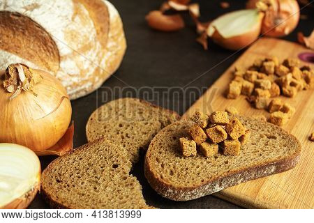Homemade Croutons With Bread With Onions, Croutons On Bread On A Dark Background, Still Life