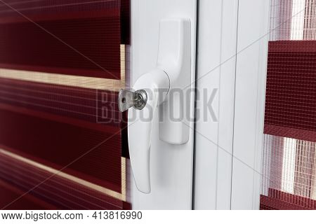 Secure Pvc Window With Lockable Handle.the Concept Of Protecting A Child From Falling Out Of Windows