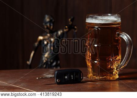 Glass Of Beer, Car Keys And Lady Of Justice. Alcohol, Car Accidents And Law Concept