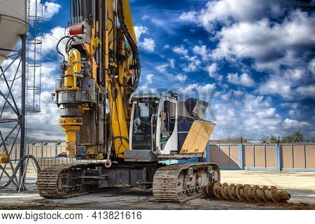Hydraulic Drilling Rig Against The Blue Cloudy Sky. Installation Of Bored Piles By Drilling. Foundat