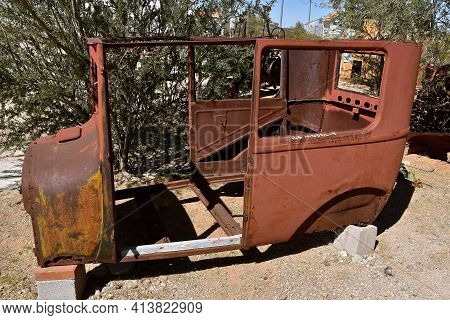 Maricopa, Arizona, February 26, 2021: The Old Rusty Model  T Body  Is A Product Of The Ford Motor Co