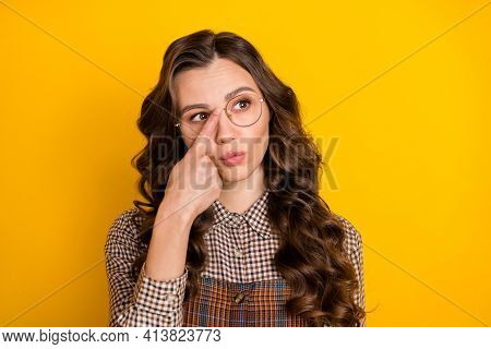 Portrait Of Attractive Genius Wavy-haired Girl Wear Checked Uniform Touching Specs Isolated Over Bri